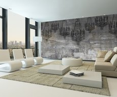 wall in a living room featuring a stunning wallpaper of chandeliers embedded in concrete