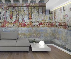 on the wall of this living room is a wallpaper representing an old advertisement of aperitif painted on the wall