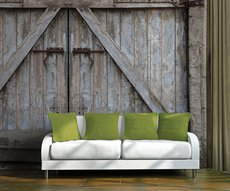 on a wall of a living room, raw material wallpaper representing an old barn door