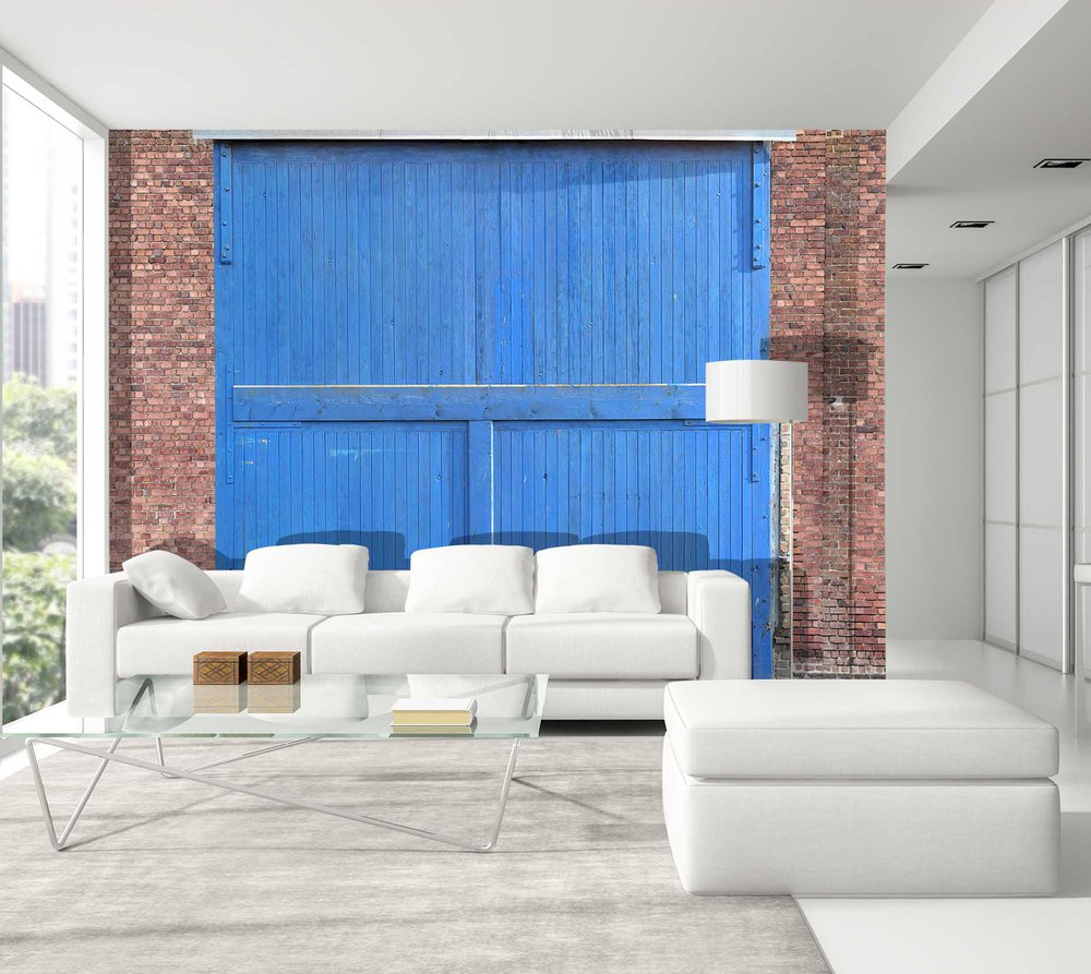 on the wall of this living room was put a wallpaper raw material representing a door of blue hangar