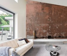 ethnic panoramic wallpaper representing a raw clay color wall in a living room
