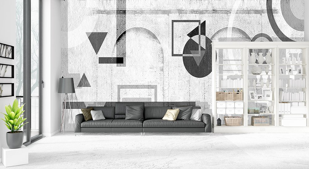 In a loft: trendy panoramic wallpaper with black geometric patterns painted on bricks