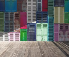 invigorating panoramic wallpaper representing multicolored shutters in a room