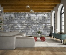 wallpaper showing a grey stone wall in a living room